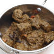 Stock Photo: Spicy Madras beef curry in kadai