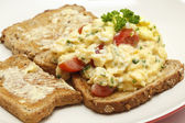 Scrambled egg with parsley and tomato — Stock Photo