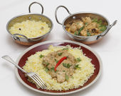 Pasanda chicken curry with serving kadai bowls — Stockfoto