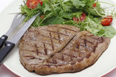 Low carb steak and salad with cutlery — Stock Photo