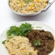 Methi lamb meal with tomato rice — Stock Photo