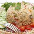 Tomato biryani and fork — Stock Photo #36412093