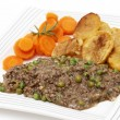 Plate of mince and peas with carrots and potato — Stock Photo #36510003