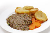 Mince and peas with carrot and saute potatoes — Stock Photo