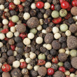 Macro of mixed peppercorns — Stock Photo