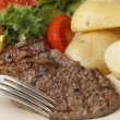Minute steak meal closeup with fork — Stockfoto