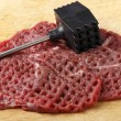 Stock Photo: Meat mallet and minute steaks