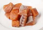 Chunks of salmon on a plate — Stock Photo