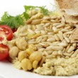 Stock Photo: Lebanese hummus and pine nuts withoil
