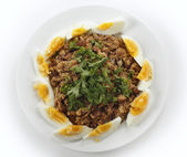 Plate of Egyptian foul with eggs — Stock Photo