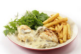 Chicken with mushroom sauce and salad side view — Stock Photo
