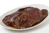Marinaded flank steak on a plate — Stock Photo