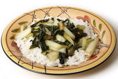 Sauteed bok choi on a bed of jasmin rice side view — Stock Photo
