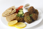 Plate of falafel with breat and salad — Stock Photo