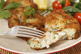 Eating homemad fishcakes — Stock Photo