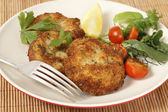 Homemade breaded fishcakes with a salad — Stock Photo