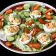 Deviled egg salad over black — Stock Photo