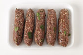 Raw lamb kofta in a tray — Stock Photo