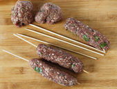 Making kofta skewers high angle — Stock Photo