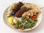 Barbecue kebab plate with tabouleh — Stock Photo