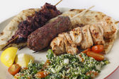 Arab style barbecue meal with tabouleh — Stock Photo