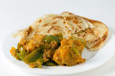 Aloo capsicum curry and paratha side view — Stock Photo