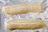 Bread dough batons rising — Stock Photo