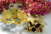 Carnival masks and golden bells — Stock Photo