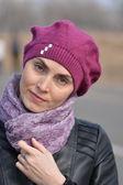 Woman in pink beret and black leather jacket on a walk — Stock Photo