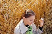 Woman in a field on a bright sunny autumn day — Stock Photo