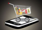Smartphone with shopping cart full with groceries — Vecteur