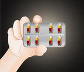 Pill in hand — Stock Vector