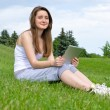 Happy woman using touchpad tablet — Stock Photo