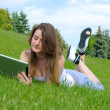 Woman relaxing with a touchscreen tablet — Stock Photo