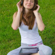 Blissful womlistening to music — Stock Photo #12585335