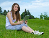 Student with touchscreen tablet — Stock Photo