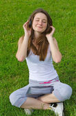 Blissful woman listening to music — Stock Photo
