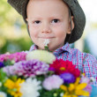 Little boy with flowers for Mum - Stock Photo