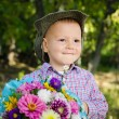 Little boy with flowers for his sweetheart - Stock Photo