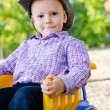 Little boy riding a toy truck - Stock Photo