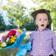 Self-conscious little boy singing - Stock Photo