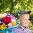 Little boy with flowers for a loved one - Stock Photo