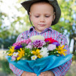 Little boy with bunch of flowers - Stock Photo