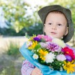 Cute little boy with floral bouquet - Stock Photo