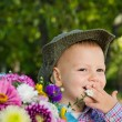 Little boy with bouquet of flowers - Stock Photo