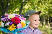 Little boy with flowers for a loved one — Stock Photo
