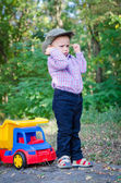 Little boy playing with his toy truck — Stock Photo