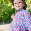 Happy little boy playing outdoors — Stock Photo