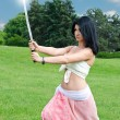 Stock fotografie: Womperforming with sword