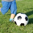 Child kicking a soccer ball — Stock Photo